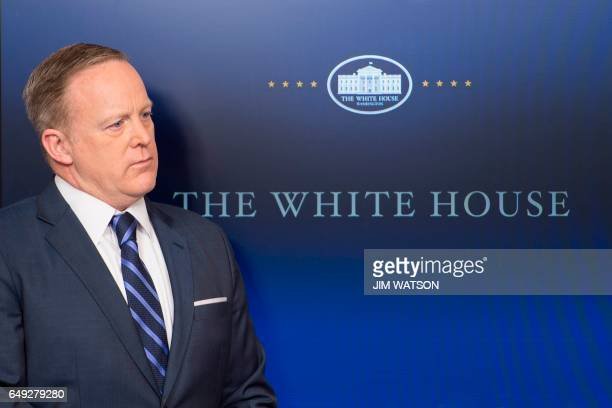 White House Press Secretary Sean Spicer looks on during the daily briefing at the White House in Washington DC March 7 2017 / AFP PHOTO / JIM WATSON