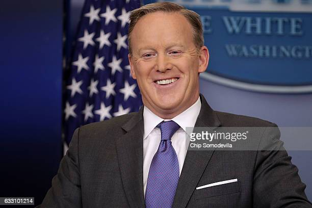 White House Press Secretary Sean Spicer reacts to reporters' questions in the Brady Press Briefing Room at the White House January 30 2017 in...