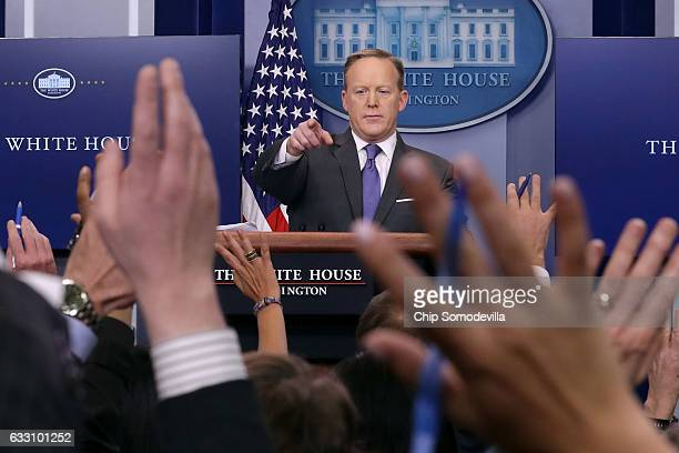 White House Press Secretary Sean Spicer reacts to reporters' questions in the Brady Press Briefing Room at the White House January 30, 2017 in...