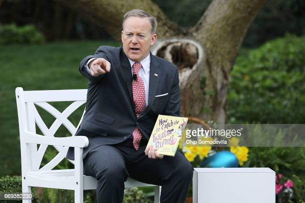 White House Press Secretary Sean Spicer reads the childrens' book 'How To Catch The Easter Bunny' during the 139th Easter Egg Roll on the South Lawn...
