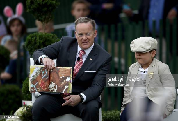 White House press secretary Sean Spicer reads to children from the book 'How to Catch the Easter Bunny' during the 139th Easter Egg Roll on the South...