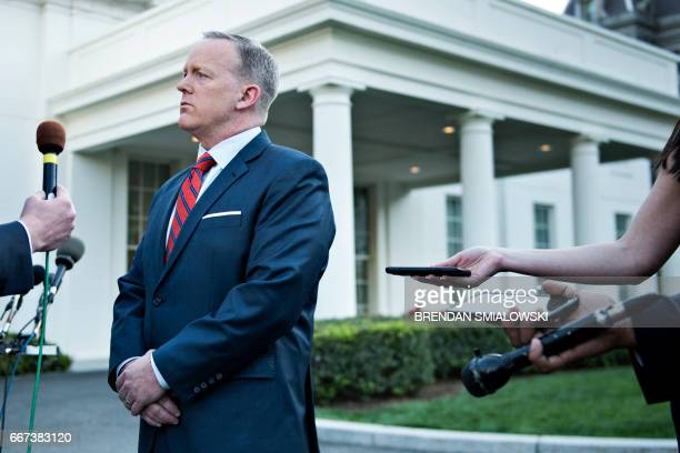 White House Press Secretary Sean Spicer speaks to a reporter about a comparison he made between Syria's President Bashar alAssad and Hitler during an...