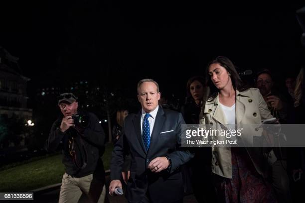 White House press secretary Sean Spicer speaks to reporters outside the West Wing after President Donald J Trump terminated FBI Director James Comey...