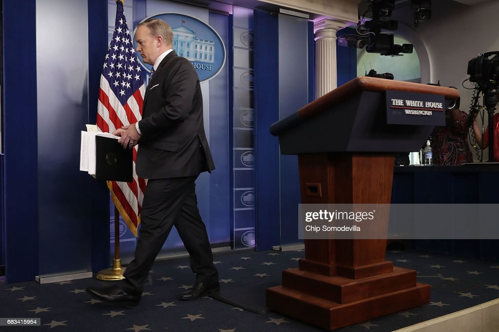 White House Press Secretary Sean Spicer steps away from the lecturn at the conclusion of the daily press breifing at the White House May 15, 2017 in Washington, DC. Reporters continued to press Spicer about President Donald Trump's Tweet about the possible existence of taped conversations at the White House but he refused to comment.