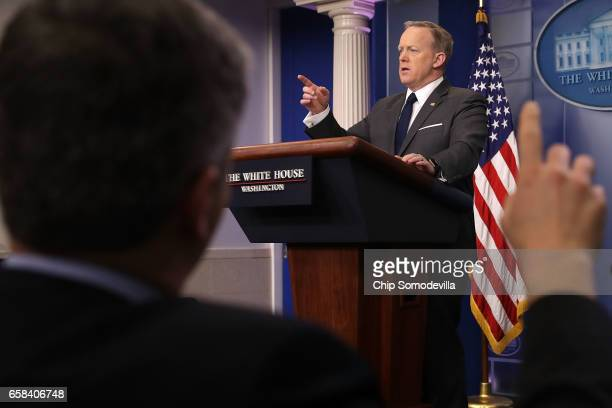White House Press Secretary Sean Spicer takes reporters' questions during the daily press briefing at the White House March 27, 2017 in Washington,...