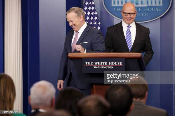 White House Press Secretary Sean Spicer turns the podium over the National Security Advisor HR McMaster during the daily news conference in the Brady...