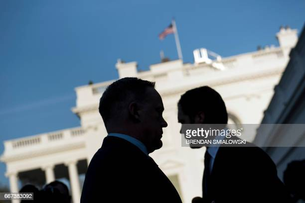 White House Press Secretary Sean Spicer walks to speak to a reporter about a comparison he made between Syria's President Bashar alAssad and Hitler...