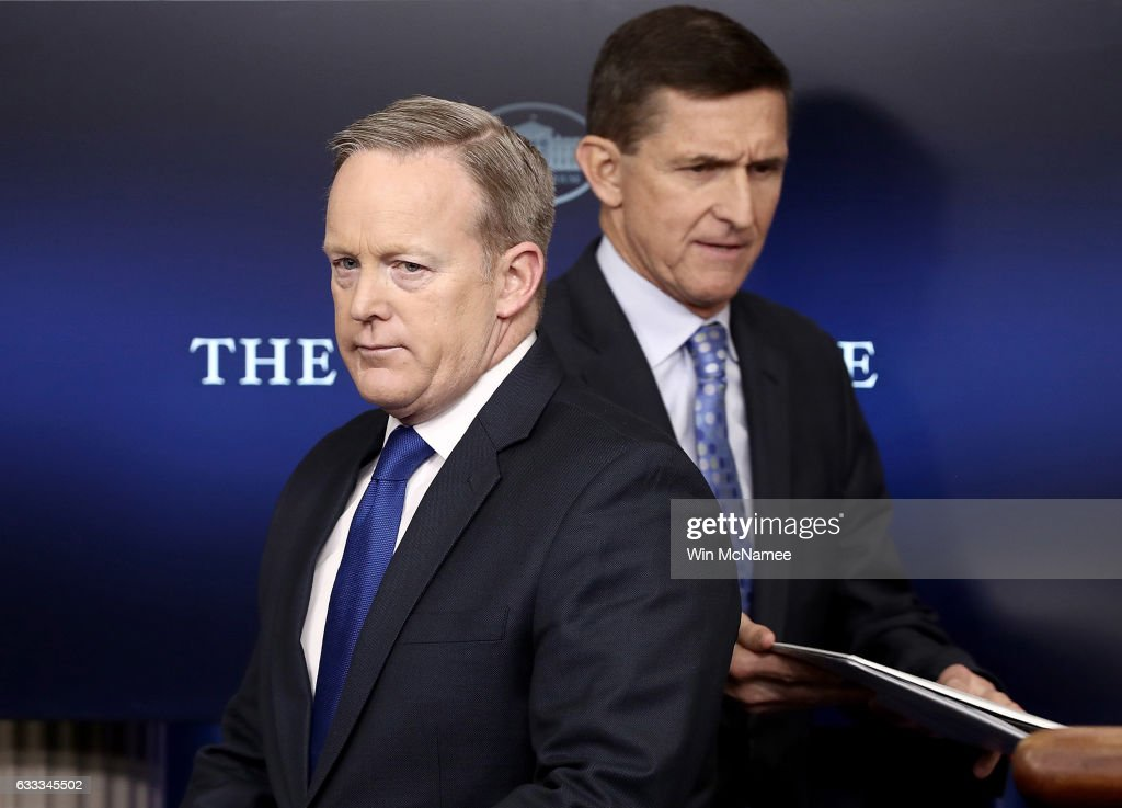White House Press Secretary Sean Spicer (L) yields the briefing room podium to National Security Adviser Michael Flynn February 1, 2017 in Washington, DC. Flynn said the White House is 'officially putting Iran on notice' for a recent missile test and support for Houthi rebels in Yemen.