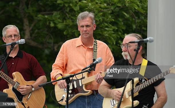 """White House Press Secretary Tony Snow rehearses with his band """"Beats Workin"""" before the annual White House Congressional Picnic on the South Lawn of..."""