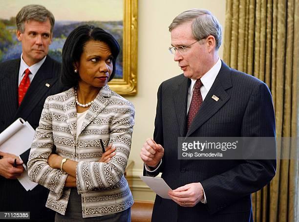 White House Press Secretary Tony Snow, Secretary of State Condoleezza Rice and National Security Advisor Stephen Hadley talk in the Oval Office while...