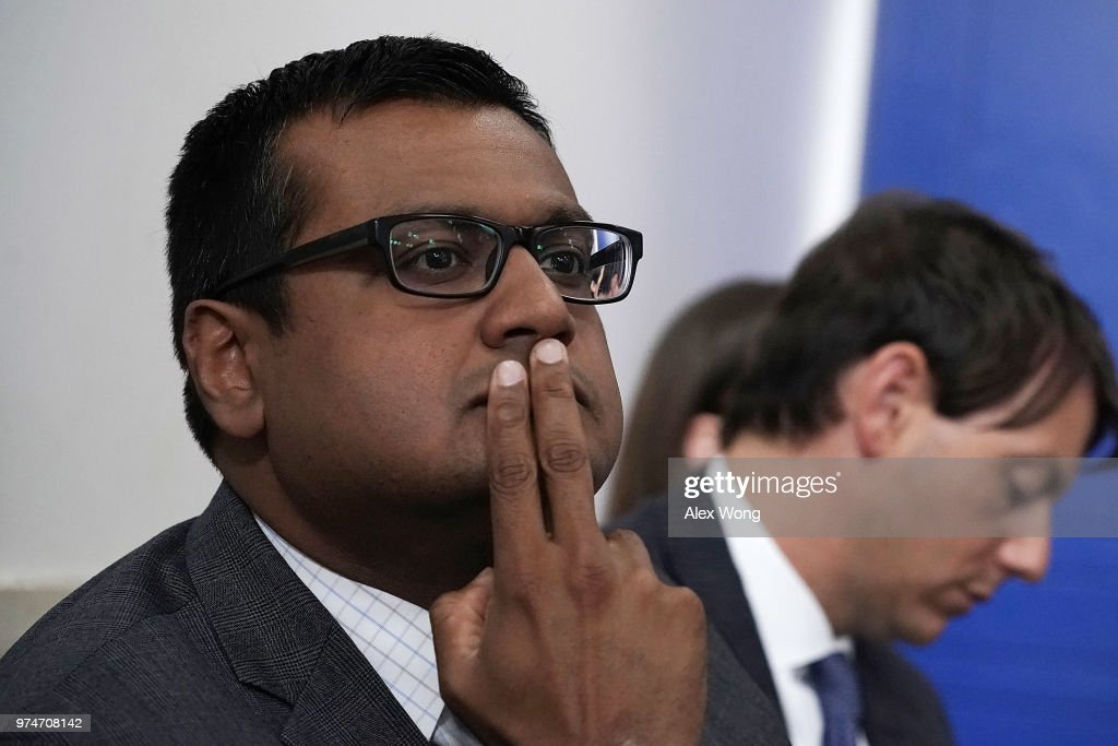 White House Principal Deputy Press Secretary Raj Shah (L) listens during a White House daily news briefing at the James Brady Press Briefing Room of the White House June 14, 2018 in Washington, DC. Press Secretary Sarah Huckabee Sanders held a daily briefing to answer questions from members of the White House Press Corps.