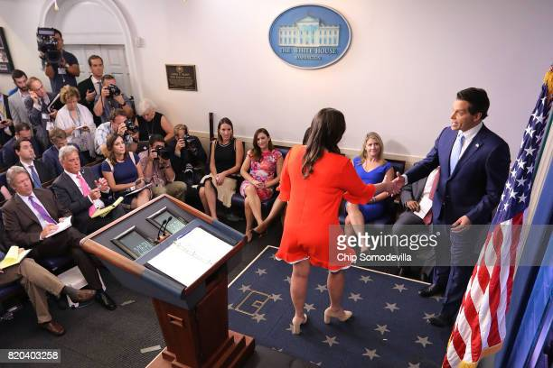 White House Principal Deputy Press Secretary Sarah Huckabee Sanders shakes hands with Anthony Scaramucci embrace during the daily press briefing in...