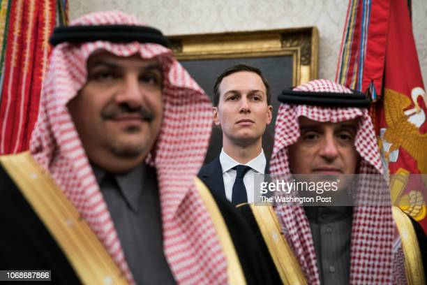 White House senior adviser Jared Kushner stands among Saudi officials as President Donald Trump talks with Crown Prince Mohammad bin Salman of the...