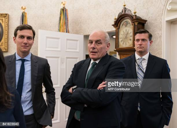 White House senior adviser Jared Kushner White House chief of staff John Kelly and White House staf secretary Rob Porter look on after US President...