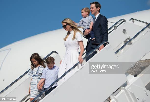 White House Senior Advisers Jared Kushner and Ivanka Trump disembark from Air Force One with their children upon arrival at Morristown Municipal...
