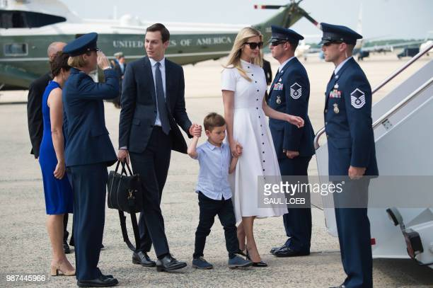 White House Senior Advisers Jared Kushner and Ivanka Trump walk to Air Force One with their children prior to departure from Joint Base Andrews in...
