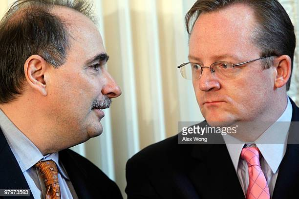 White House Senior Advisor David Axelrod talks to White House Press Secretary Robert Gibbs prior to the signing ceremony of the Affordable Health...
