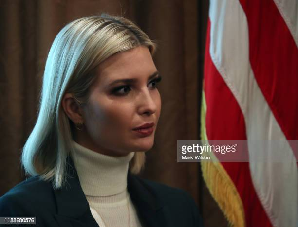 White House Senior Advisor Ivanka Trump listens to her father US President Donald Trump speak to the media during a cabinet meeting at the White...