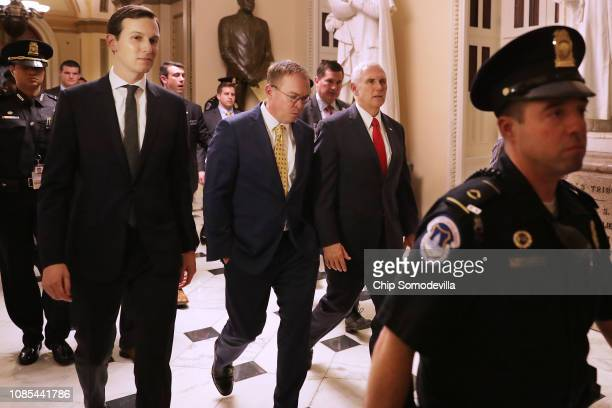 White House Senior Advisor Jared Kushner acting Chief of Staff Mick Mulvaney and Vice President Mike Pence walk from the House of Representatives to...