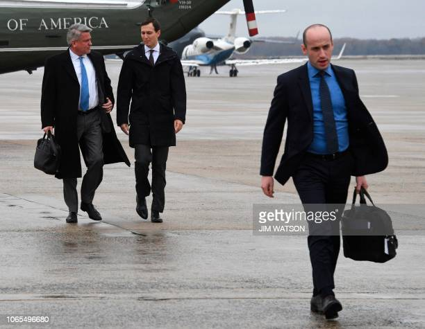 White House Senior Advisor Jared Kushner and advisor Stephen Miller walk to Air Force One prior to departure from Joint Base Andrews in Maryland on...