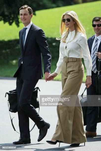 White House Senior Advisor Jared Kushner and his wife Ivanka Trump leave the White House June 1 2018 in Washington DC The family members are...