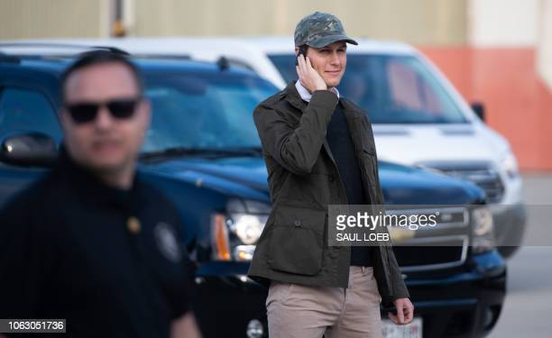 White House Senior Advisor Jared Kushner speaks on the phone after disembarking from Air Force One upon arrival with US President Donald Trump at...