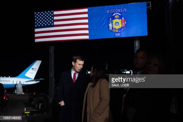 White House Senior Advisor Jared Kushner speaks with White House Press Secretary Sarah Sanders as US President Donald Trump holds a campaign rally at...
