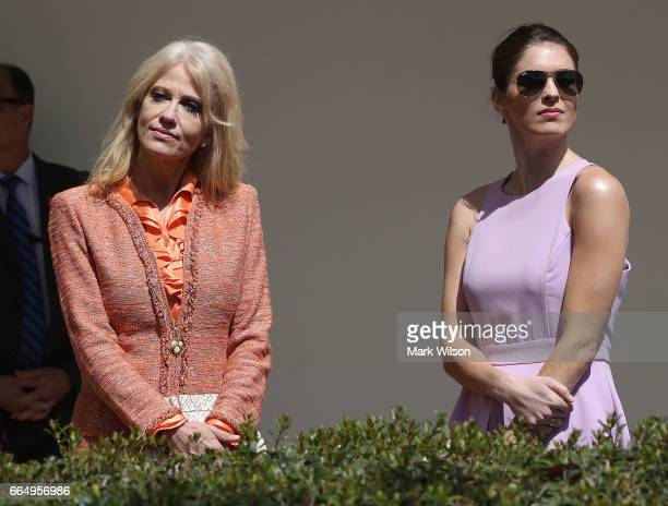 White House Senior Advisor Kellyanne Conway stand with White House Communications Director Hope Hicks during a news conference with US President...