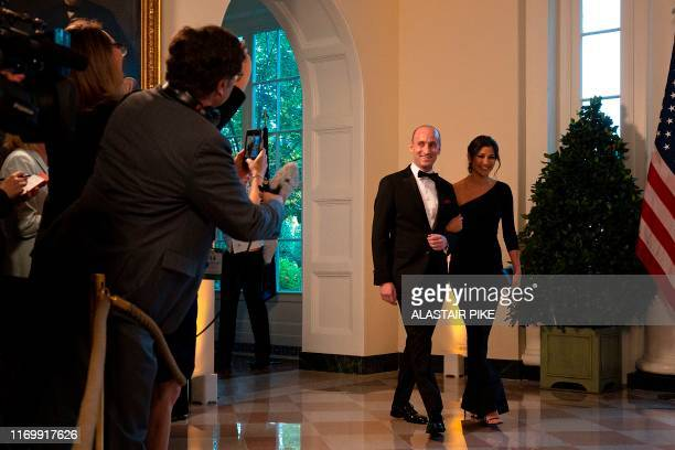 White House Senior Advisor Stephen Miller and Katie Waldman arrive in the Booksellers area of the White House to attend an Official Visit with a...