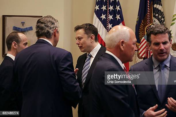 White House Senior Advisor Stephen Miller and Klaus Kleinfeld of Arconic visit with Elon Musk of SpaceX before a meeting with US President Donald...