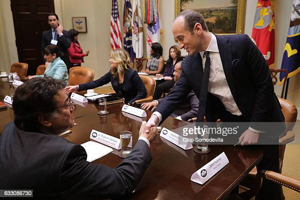White House Senior Advisor Stephen Miller greets Minority Business Round Table CEO Roger Campos and other small business people before a meeting with...