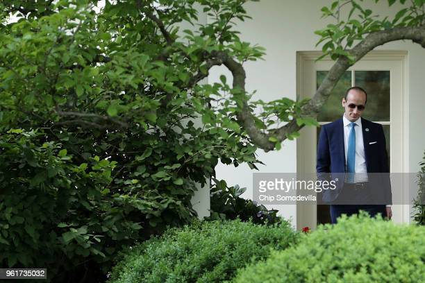 White House Senior Advisor to the President Stephen Miller waits outside the Oval Office for US President Donald Trump to depart the White House May...