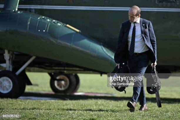 White House Senior Advisor to the President Stephen Miller walks across the South Lawn after arriving back at the White House April 5 2018 in...