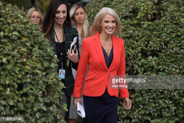 White House senior counselor Kellyanne Conway approaches members of the media outside the West Wing of the White House October 25, 2019 in...