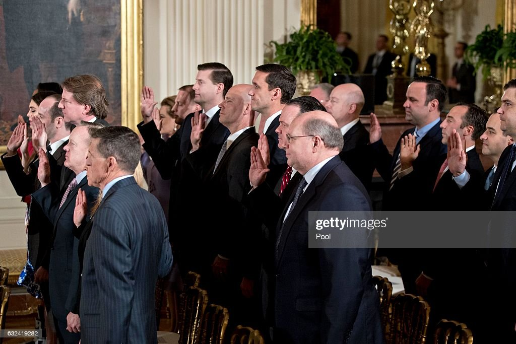 White House senior staff members are sworn in by U.S. Vice President Mike Pence, not pictured, during a ceremony in the East Room of the White House on January 22, 2017 in Washington, DC. Trump today mocked protesters who gathered for large demonstrations across the U.S. and the world on Saturday to signal discontent with his leadership, but later offered a more conciliatory tone, saying he recognized such marches as a 'hallmark of our democracy.'