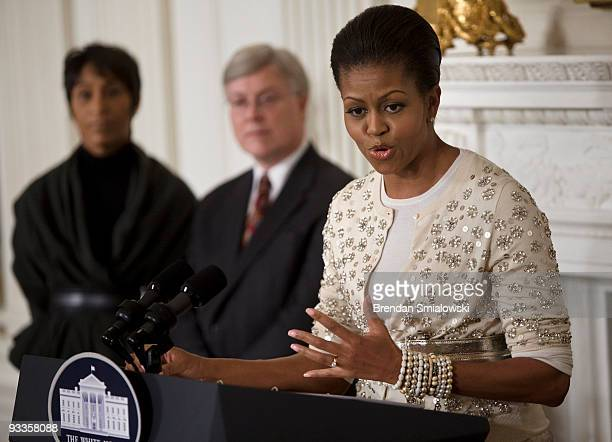 White House Social Secretary Desiree Rogers and White House Curator William Allman listen while First Lady Michelle Obama speaks at a preview for...
