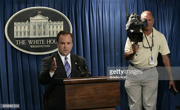 White House spokesman Scott McClellan left delivers the daily briefing in Washington DC July 13 2005 McCellan was questioned vigorously by members of...