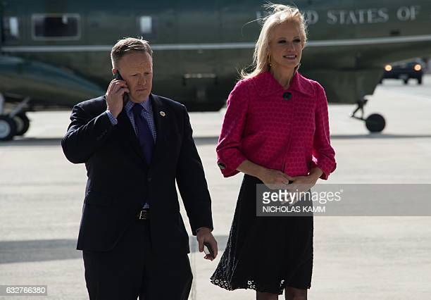 White House spokesman Sean Spicer and adviser Kellyanne Conway wait for the arrival of US President Donald Trump under the wing of Air Force One at...
