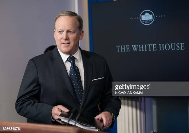 White House spokesman Sean Spicer arrives at a press briefing at the White House in Washington DC on June 20 2017 / AFP PHOTO / NICHOLAS KAMM