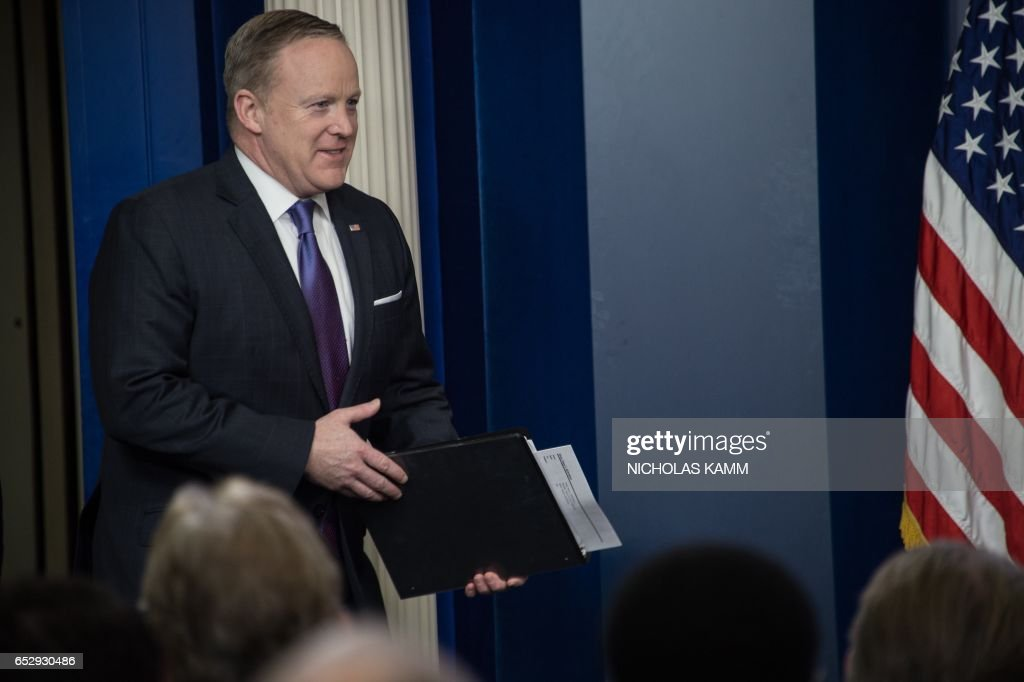 White House spokesman Sean Spicer arrives for the daily press briefing at the White House in Washington, DC, on March 13, 2017. /