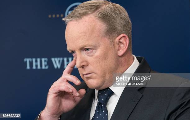 White House spokesman Sean Spicer gestures during a press briefing at the White House in Washington DC on June 20 2017 / AFP PHOTO / NICHOLAS KAMM