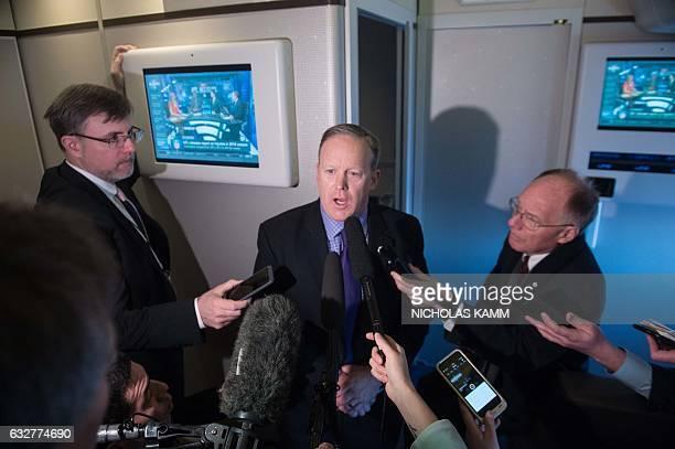 White House spokesman Sean Spicer speaks to the press aboard Air Force One as US President Donald Trump returns to WashingtonDC from Philadelphia on...