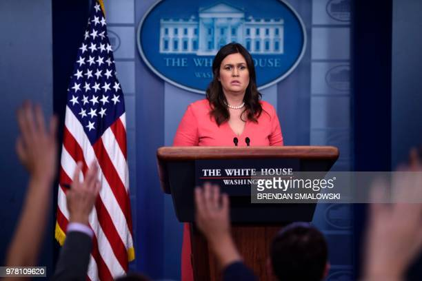 White House spokesperson Sarah Huckabee Sanders takes questions during a press briefing at the White House in Washington DC on June 18 2018