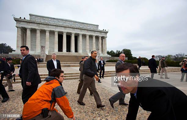 White House staff and Secret Service scramble out of the way as US President Barack Obama makes a surprise visit to the Lincoln Memorial a day after...