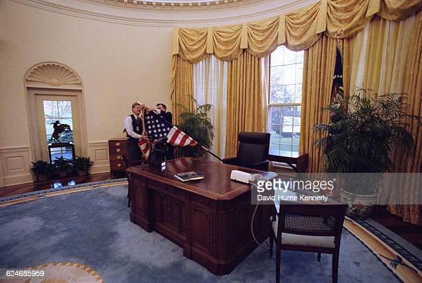 White House Staff change the furnishings of the Oval Office while newly elected Bill Clinton is being sworn in as the 42nd President of the United...
