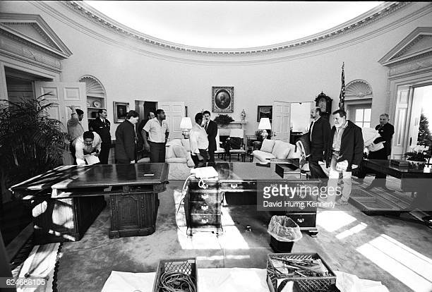 White House Staff change the furnishings of the Oval Office while newly elected Bill Clinton is being sworn in as President of the United States on...
