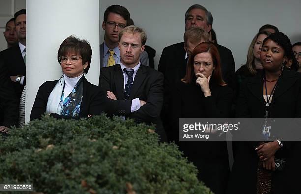 White House staff including Press Secretary Josh Earnest senior advisor Valerie Jarrett and Communication Director Jen Psaki listen as US President...