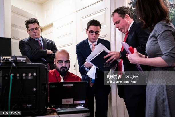 White House staff members prepare the speech on the teleprompter before President Donald J. Trump arrives to deliver remarks about the shootings this...