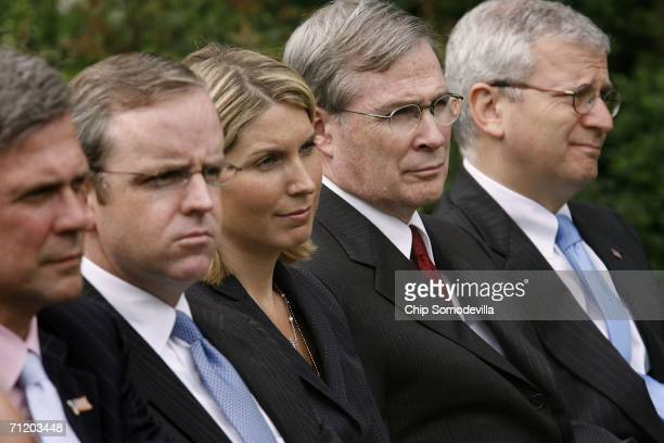 White House staff members Tony Snow, Dan Bartlett, Nicole Wallace, Stephen Hadley and Joshua Bolten listen to U.S. President George W. Bush as he...
