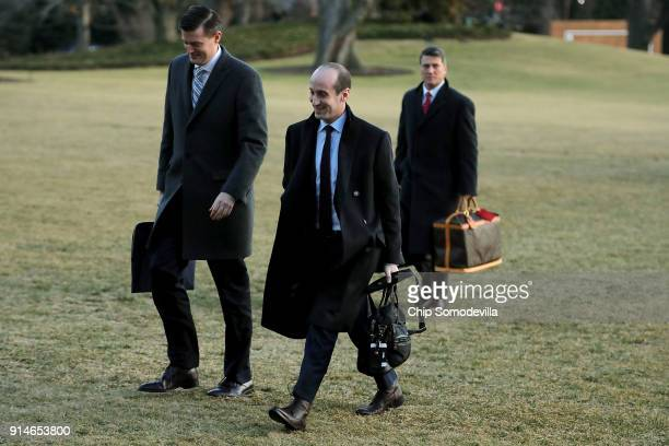 White House Staff Secretary Rob Porter and Senior Advisor to the President Stephen Miller return to the White House after a day trip with President...